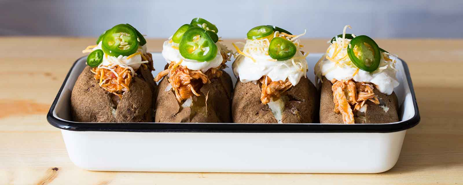 Spicy Ranch Pulled Chicken Loaded Baked Potatoes