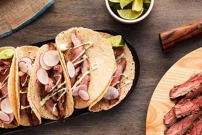 Ranch-Rubbed Carne Asada Tacos with Avocado Crema